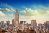 Manhattan Skyscrapers with dramatic Sky on background — Stock Photo