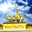 Royalty-Free Stock Photo: Majesty of Quadriga over Brandenburg Gate, with dramatic Sky