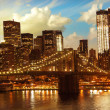 Stock Photo: Brooklyn Bridge and Lower Manhattan Skyline at Sunset