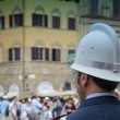 Royalty-Free Stock Photo: Policeman looking at the Crowd in Florence, Italy
