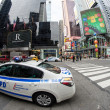 Stock Photo: NEW YORK CITY - MAR 6: Times Square in morning with NYPD car in