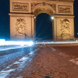 Arc De Triomphe and light trails in Paris, Upward view — Stock Photo