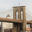 Portrait view of Brooklyn Bridge Tower and flag in New York City — Stock Photo