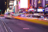NEW YORK - MARCH 7: Yellow cabs speed through Times Square landm — Stock Photo