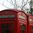 Two classic red London Telephone boxes, in the City of London, E - Lizenzfreies Foto