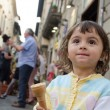 Baby girl eating Ice Cream in the City Streets — Stock Photo