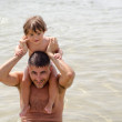 Baby Girl happy to play with her Father at the beach — Stock Photo