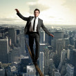 Equilibrist businessman - Stock Photo