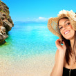 Brunette girl on the beach — Stock Photo