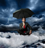 Businessman and the storm — Stock Photo