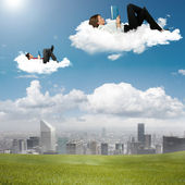 Business reading book in the sky — Stock Photo