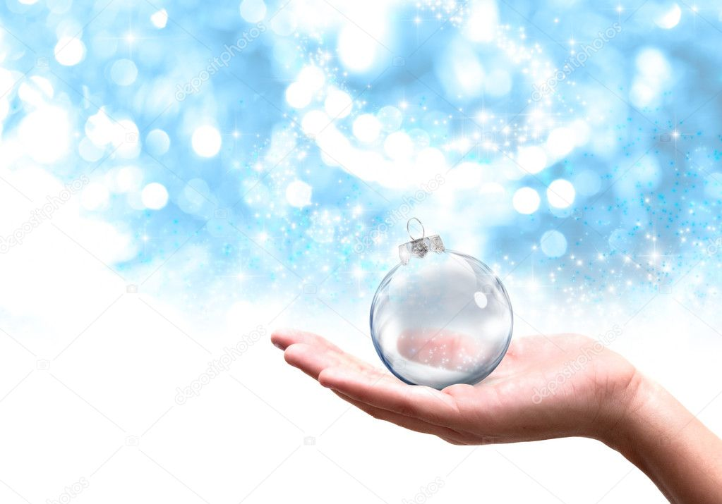 Hand that hold a modern Christmas ball  Stock Photo #11015582
