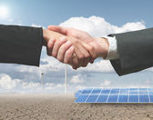 Renewable energy handhsake — Stock Photo