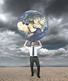 Businessman protects the world — Stock Photo