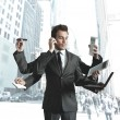 Businessman multitasking — Stock Photo