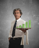 Businessman and positive statistics — Stock Photo