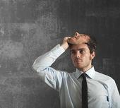 Podnikatel a maska — Stock fotografie