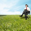 Businessman enjoying a relaxing day - Stock Photo