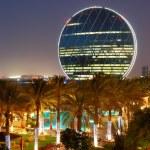 Night illumination in the luxury hotel and circular building, Ab — Stock Photo