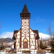 The old wooden Catholic church at ski resort, Tatranska Lomnica, — Stock Photo #11437791