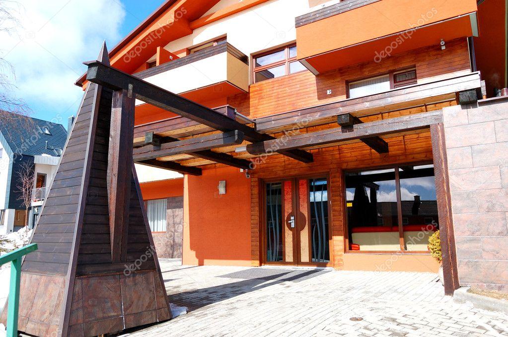 Entrance of modern luxury hotel at ski resort high tatras for Moderne skihotels