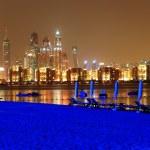 Night illumination of the luxury hotel beach on Palm Jumeirah ma — Stock Photo