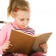 Little girl with book — Stock Photo #11394412