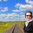 Young business woman on the railway. — Stock Photo