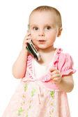 Holčička mluví po telefonu v růžových šatech — Stock fotografie