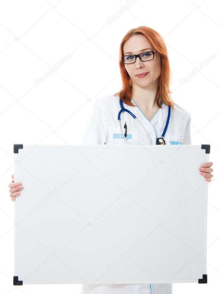 Smiling medical doctor woman holding blank billboard  isolated on white  Stock Photo #11395101