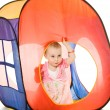 Kid looks out the window tent - Stock Photo