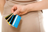 Woman with many different credit cards — Stock Photo