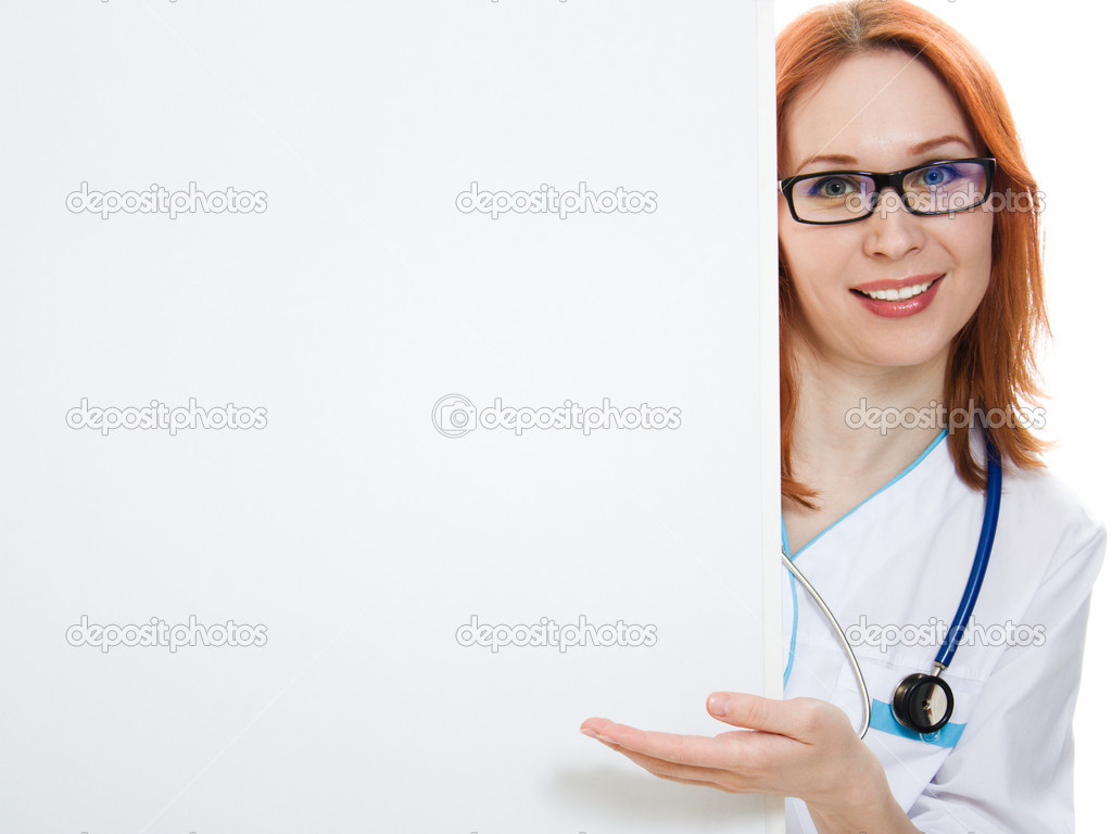 Smiling medical doctor woman holding blank billboard  isolated on white  Stock Photo #11463957