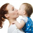 Mother kissing her daughter — Stock Photo #11833293