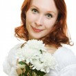 Portrait of beautiful young woman with flowers on white background — Stock Photo #11833409