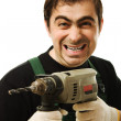 male worker with an electric dril — Stock Photo