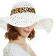 Girl in the white hat hiding his eyes — Stock Photo #11833479