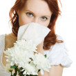Young woman having spring flowers allergy sneezing over white background — Stock Photo