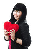 Beautiful woman with a heart — Stock Photo