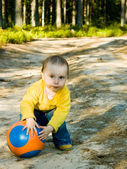 Little baby plays with ball — Stock Photo