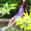 Stock Photo: Beautiful girl in summer garden