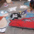 PASADENA, CA-USA - JUNE 19 2011: Painting Art Murals with chalk on street at the 19th Annual Pasadena Chalk Festival held on June 18 and 19 2011 at Paseo Colorado - Stock Photo