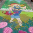 PASADENA, CA-USA - JUNE 19 2011: Painting Art Murals with chalk on street at the 19th Annual Pasadena Chalk Festival held on June 18 and 19 2011 at Paseo Colorado — Stockfoto