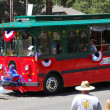 Stock Photo: MAMMOTH LAKES, CA-US- JULY 4 2011: Independence Day Parade volunteers trolley