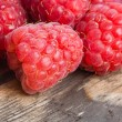 Raspberry on wood background selective focus — Stockfoto