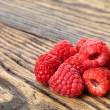 Stock Photo: Raspberry on wood background selective focus