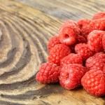 Raspberry on wood background selective focus — Stock Photo