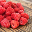 Raspberry on wood background selective focus — Stock Photo