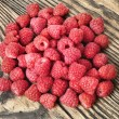 Raspberry on wood background selective focus. Fresh organic food. - Stock fotografie