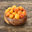 Apricots on wood background selective focus - Stock fotografie